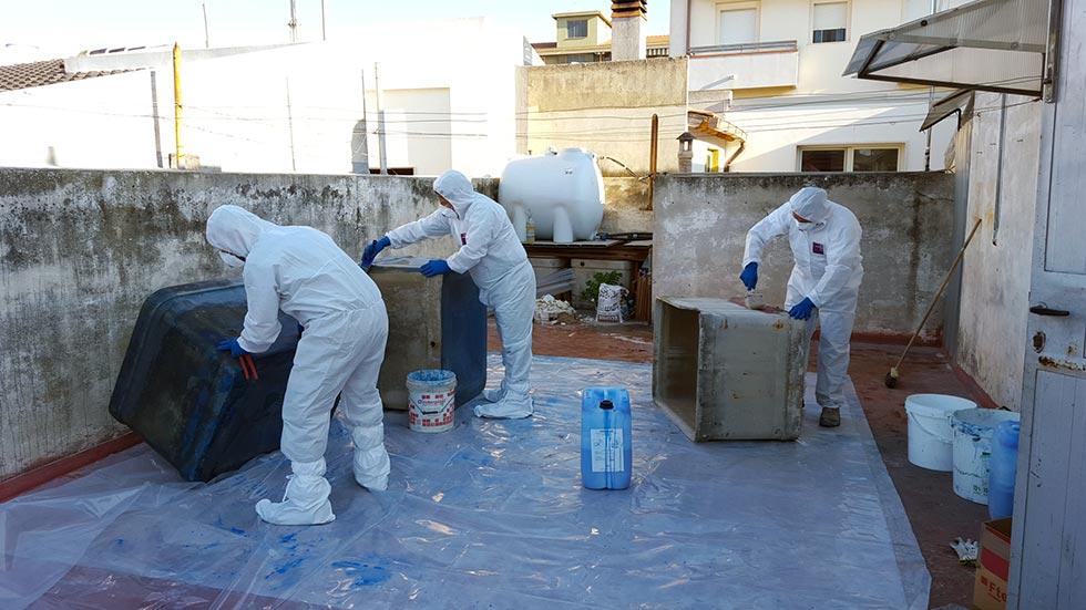 Bonifica e smaltimento di recipienti in amianto